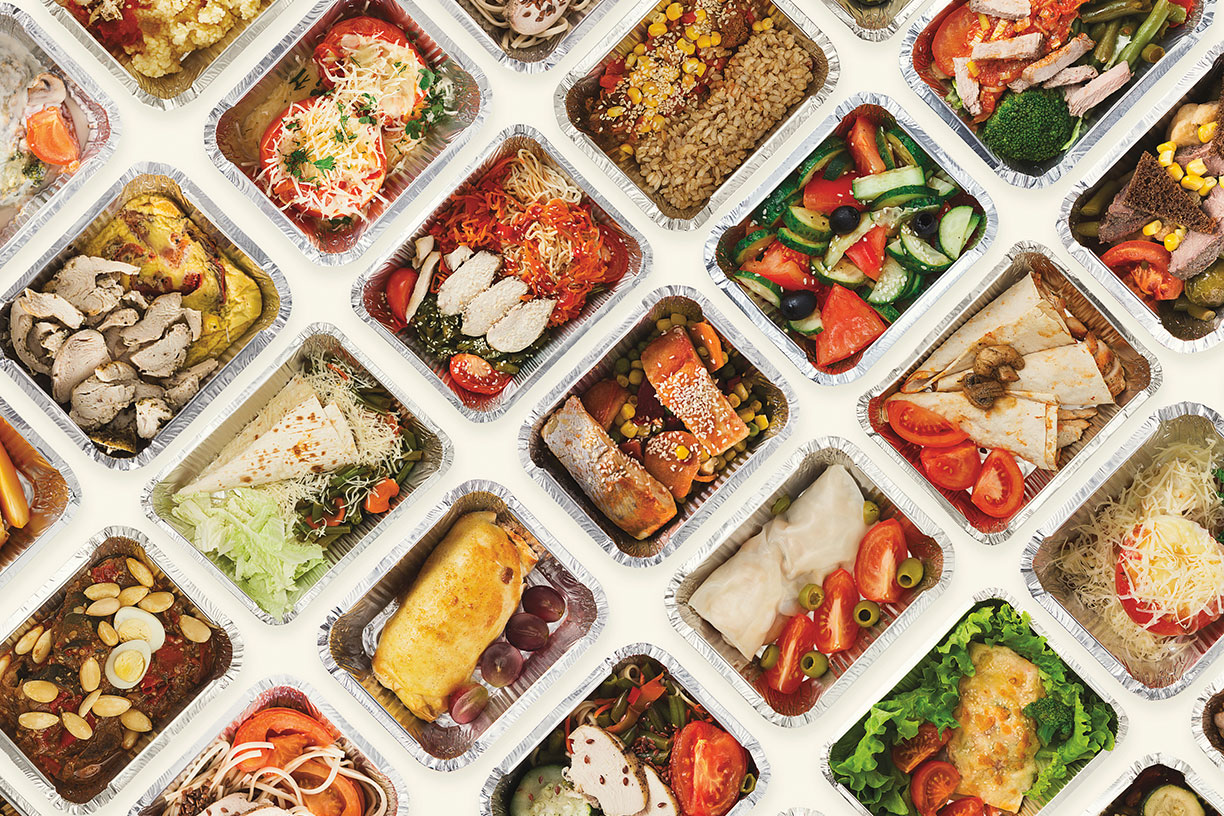 Diagonal rows of takeout containers holding colorful food