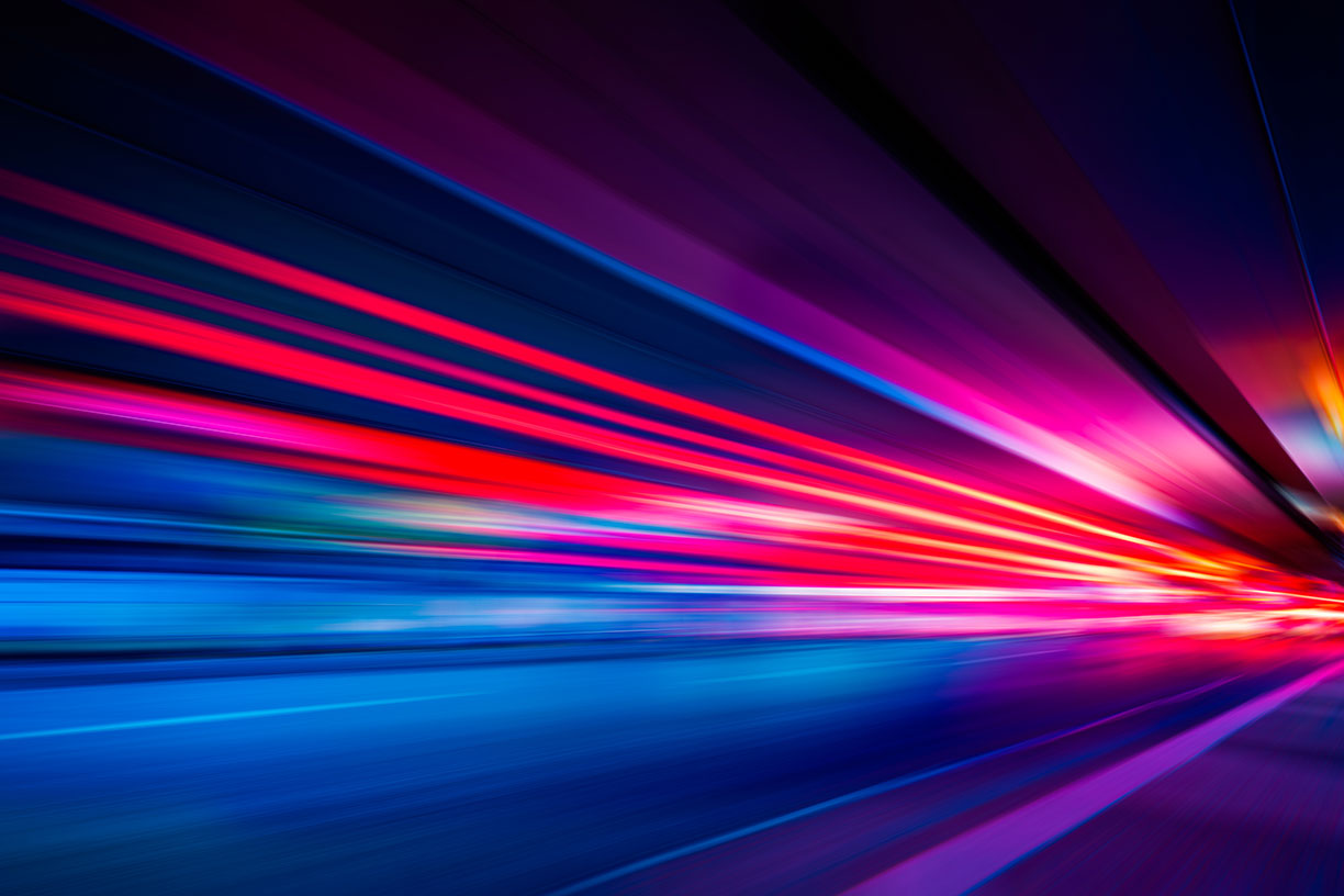 red purple and blue line streaks on black background